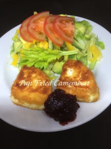 pan fried camembert served with redcurrant sauce