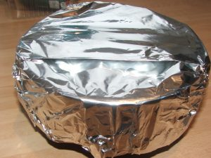 Pudding ready for steamer covered with foil