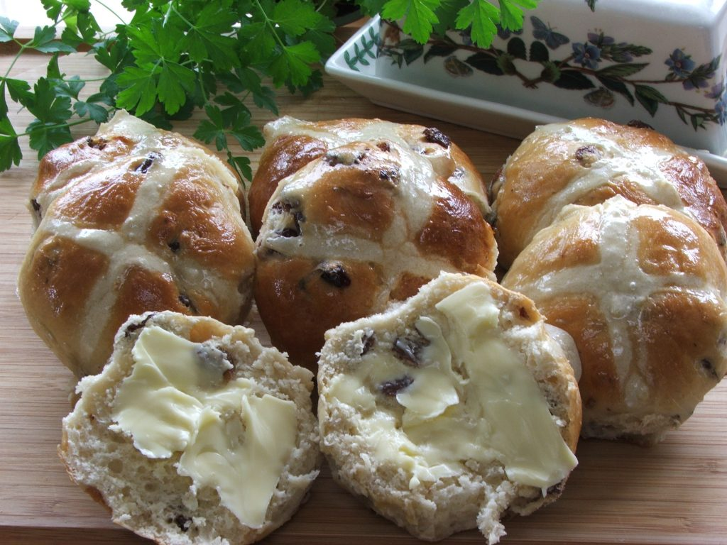 Hot Cross Buns with one bun buttered